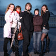 Stock fotografie: Young people standing in city square