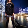 Woman standing on illuminated street at night. — Stock Photo #32906879