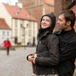 Couple hugging in an old european town square. — Stock Photo