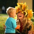 Mother playing with son in an autumn park. — Stock Photo