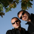 Two tough man in sunglasses outdoors — Stock Photo