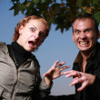 Stock Photo: Scary looking couple portrait.