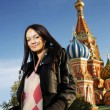Stock Photo: Young womnext to Saint Basil's Cathedral