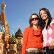 Young women next to Saint Basil's Cathedral — Stock Photo