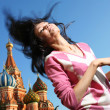 Stock Photo: Girl in euphoriwaves her long hair over blue sky at Red Square