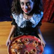 Horror girl with tray of treats. — Stock Photo