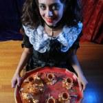 Horror girl with tray of treats. — Stock Photo #32907593