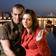 Young couple in night city — Stock Photo