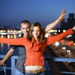 Loving young couple in night city — Stock Photo