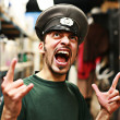 Man in military service cap shouting — Stock Photo