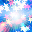 Holiday background with rays and stars — Stock Photo