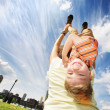 Boy hanging upside down on mother's back — Stock Photo