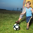 Boy playing football with his dad outdoors — Zdjęcie stockowe