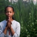 Teenage girl praying — Stock Photo