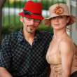 Couple in beautiful designer hats. — Stock Photo