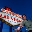 Woman in front of Welcome To Las Vegas Sign — Stock Photo