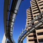 Futuristic monorail going around skyscrapers — Stock Photo #32909169