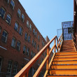 Stairway going up in an old downtown building — Stock Photo