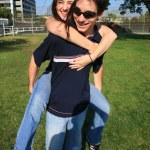 Couple playing piggyback ride — Stock Photo