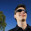 Smiling young man in sunglasses — Stock Photo #32909661