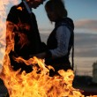 Young couple silhouette with fire — Stock Photo