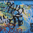 Blue background covered by layers of graffiti — Stock Photo