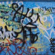 Stock Photo: Blue background covered by layers of graffiti