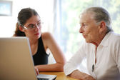 Grandmother and granddaughter with laptop. — Stock Photo