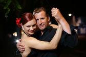 Young adult couple dancing tango — Stock Photo