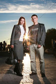 Young couple standing on a street — Stock Photo