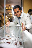 Businessman selling diamond jewellry — Stock Photo