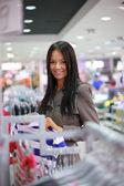 Beautiful girl shopping in a store — Stock Photo