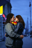 Young loving couple kissing in a city. — Stock Photo