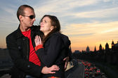 Young couple in Moscow city at sunset — Stock Photo