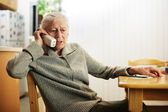 Senior woman talking on the phone — Stock Photo