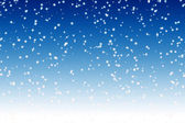 Falling snow over night blue winter sky — Stock Photo