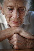 Senior woman pondering — Stock Photo