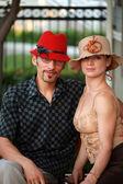 Couple in beautiful designer hats. — Stock Photo