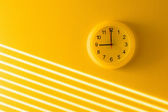 Yellow wall & clock — Stock Photo