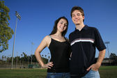 Couple embracing on a football field. — Stock Photo