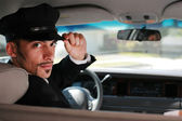 Chauffeur sitting in a car — Stock Photo