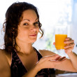 Woman with a glass of orange juice. — Stock Photo