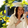 Stock Photo: Graduate womhappy with diploma