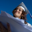 Young graduate woman with heap of papers. — Stock Photo