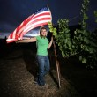 Young woman standing with American flag — Stok fotoğraf #32910333