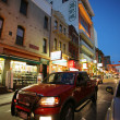 Street traffic in Chinatown at dusk — Stock Photo