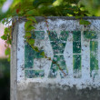 Old stencil exit sign — Stockfoto