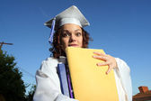 Student holding a big pile of textbooks — Stock Photo
