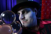 Magician with crystal balls — Stock Photo