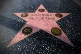 La estrella en el paseo de la fama de hollywood — Foto de Stock